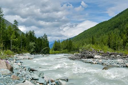 range of motion: Akkem river flowing from glacier and Beluha range Stock Photo