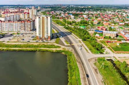 sameness: Tyumen, Russia - July 29, 2015: Aerial view on city quarters. Tura neighborhood. Zapadno-Sibirskaya Street