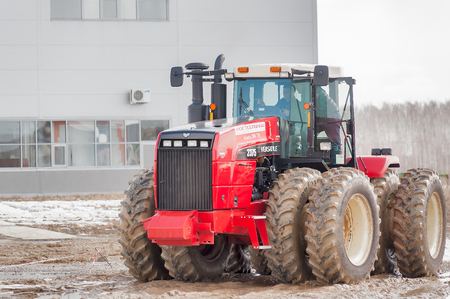 specialized job: Tyumen, Russia - April 04. 2014: IV Tyumen specialized exhibition Agricultural Machinery and Equipment. Test-drive of tractor on special dirt range