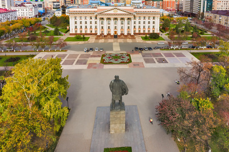 establishment states: Tyumen, Russia - September 17, 2015: Aerial view onto monument to Lenin and building of Tyumen region Government Editorial