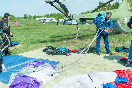 parachutists: Yalutorovsk, Russia - May 24, 2008: Competition of parachutists on landing accuracy on sport airdrome. Preparations of parachutists for a new jump