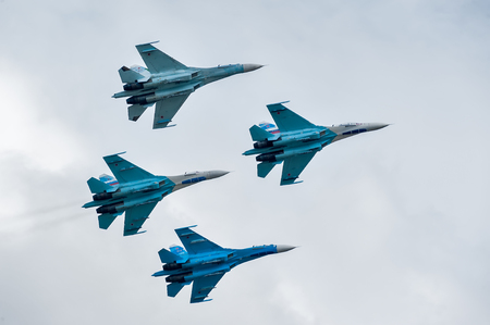 pilotage: Nizhniy Tagil, Russia - September 25. 2013: Group flight of russian highest pilotage team on SU-27. Display of fighting opportunities of equipment with application of aviation means of defeat