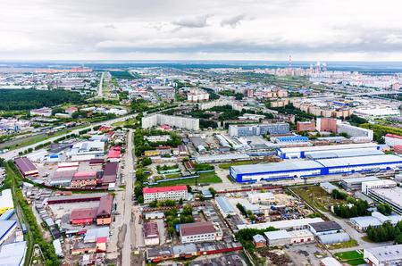 parking facilities: Tyumen, Russia - August 9, 2015: Bird eye view on industrial companies district on Energetikov street Stock Photo