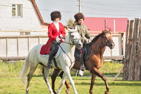 cossacks: Tyumen, Russia - September 22, 2012: Avanpost training center on preparation of school students for army. Miles of Fire festival of live history.  Show of Cossacks on horses