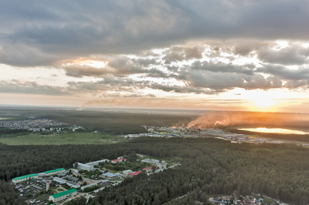 lunatic: Vinzili, Russia - June 12, 2015: Bird eye view onto regional clinical lunatic asylum and industrial area at sunset. Tyumen region