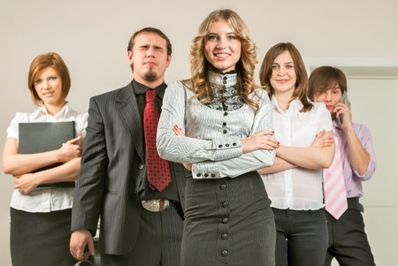 happy business team: Happy business team with arms crossed at the office Stock Photo