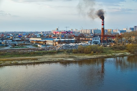 transferred: Tyumen, Russia - May 6, 2008: Plywood factory on river bank. Now it is transferred to industrial zone of suburb, and buildings are demolished Stock Photo