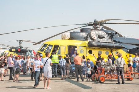 heliport: Tyumen, Russia - August 11, 2012: Air show On a visit at UTair in heliport Plehanovo. People explore the MI-10K  helicopter