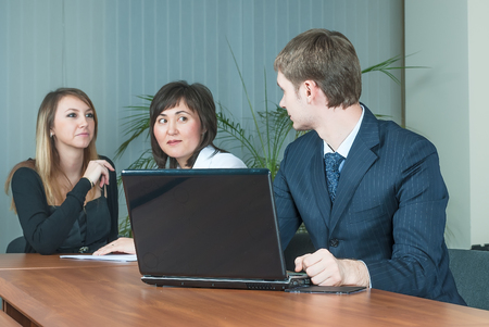 employers: Office people. Three employers working in team for company success Stock Photo