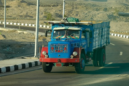 truck driver: Hurghada, Egypt - November 13, 2006: Old truck driven by arabian driver moves on intercity road Editorial