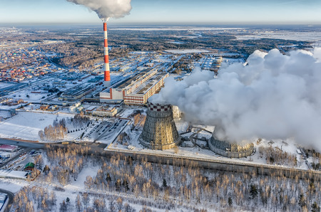 tall chimney: Tyumen, Russia - November 17, 2015: Aerial view on combined heat and power factory number 2 and city quarters