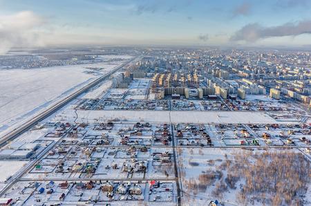 Tyumen, Russia - November 17, 2015: Residential district on Fedyuninskaya street from air. Bypass road on city boundary Stock Photo