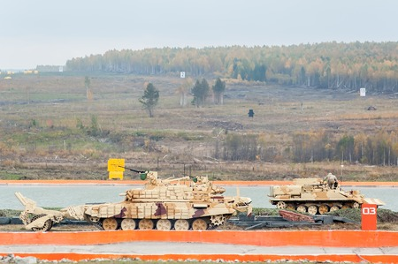 clearer: Nizhniy Tagil, Russia - September 25. 2013: BMR-3M. Armoured deminer to demine pathways for convoy. It move on shooting demonstration range. RAE-2013 exhibition