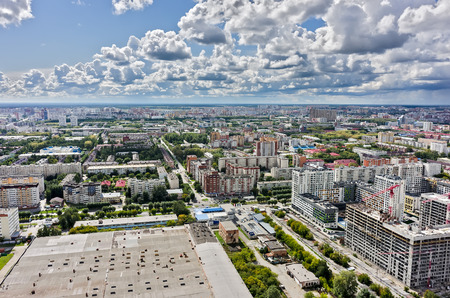 residental: Tyumen, Russia - August 13, 2015: Aerial view on lifting cranes on Novin residental house construction site. Harkovskaya street