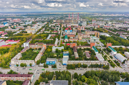 infrastructure buildings: Tyumen, Russia - August 25, 2015: Bird eye view on urban quarters. Space cinema house and building of Savings Bank. Respubliki and Tulskaya streets Editorial