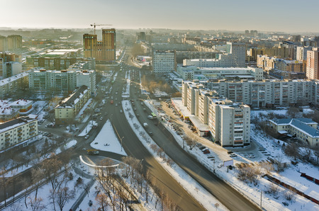housing lot: Tyumen, Russia - December 2, 2015: Aerial view onto Profsoyuznaya street and construction of conceptual housing estate of Fifty Fifty