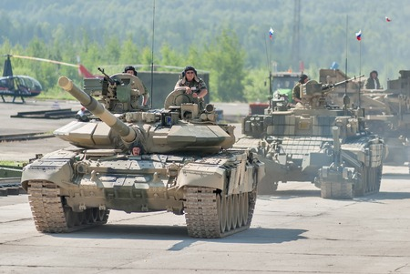 armoured: Nizhniy Tagil, Russia - July 12. 2008: Modernized tank T-72, BMR-3M armoured deminer and guard move on shooting demonstration range. RAE-2008 exhibition