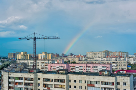 Tyumen, Russia - July 19, 2014: Aerial view onto residential district on Scherbakova street with construction site and rainbow