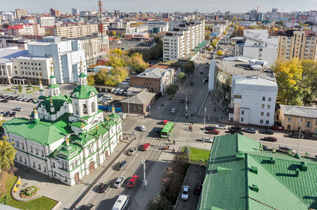 lenina: Tyumen, Russia - September 24, 2014: Aerial view on church of Saviour, Lenina and Chelyuskincev streets intersection and regional philharmonic hall behind chapel
