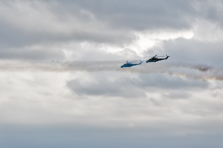 uncontrollable: Nizhniy Tagil, Russia - July 12. 2008: Russian military helicopters mi-24 let out thermal trap and do volley by uncontrollable rockets. Russia Arms Expo-2013