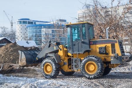 Bulldozer removes debris from demolition of old derelict buildings