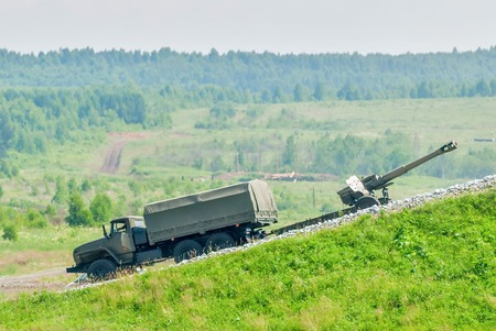 barrel bomb: Nizhniy Tagil, Russia - July 12. 2008: army truck with cannon moving to destination point. Russia Arms Expo