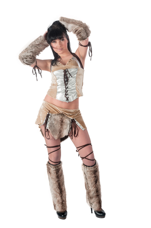 Young beautiful woman in barbarian costume. Isolated over white background photo