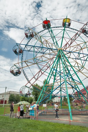 Golyshmanovo, Russia - July 9, 2011: Little old ferris wheel in park photo
