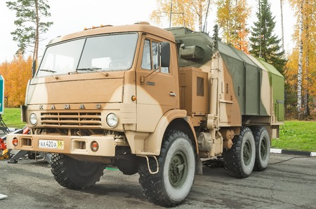 unified: Nizhniy Tagil, Russia - September 26. 2013: Demonstration platform for survey of equipment by visitors. MP32M1 unified command and control vehicle on KAMAZ 43114 base. Russia Arms Expo-2013 exhibition Editorial