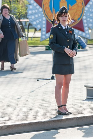 security uniform: Tyumen, Russia - May 9. 2009: Victory Day holiday. Young policewoman - sergeant stands and protects an order during parade