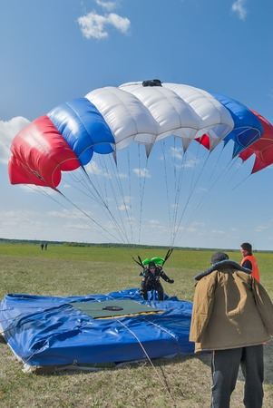 parachutists: Yalutorovsk, Russia - May 24, 2008: Competition of parachutists on landing accuracy on sport airdrome. Parachutist landed near a target
