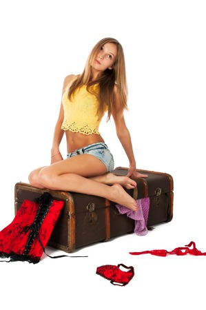 Young beautiful blonde sad woman girl going to travel photo