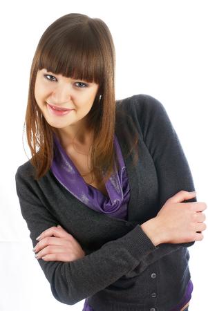 ni�as sonriendo: Mujer hermosa joven con sonrisa sobre el fondo blanco aislado