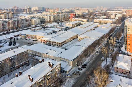 winter park: Tyumen, Russia - January 23, 2016: Aerial view on On Minskoy shopping center. There was netknitting factory in past Editorial