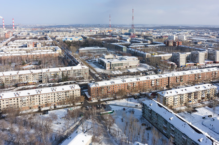 entertaining area: Tyumen, Russia - January 23, 2016: Aerial view onto residential area, entertaining institution of builders and TV towers on background