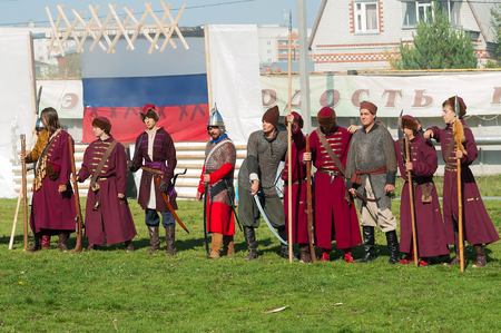 caftan: Tyumen, Russia - September 22, 2012: Avanpost training center. Miles of Fire festival of live history. Reenactors in 18th century russian army infantry officer uniform show acrobatic skill. Camelot club