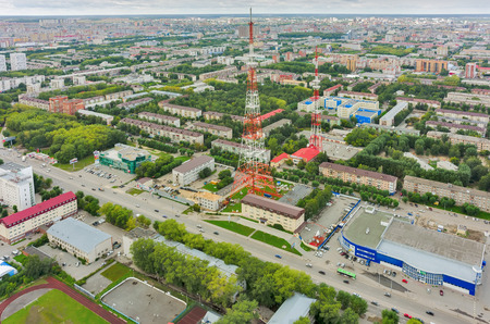 prosecutor: Tyumen, Russia - August 9, 2015: Bird eye view onto prosecutor office of Central joint-stock company, TV towers and residential districts at summer