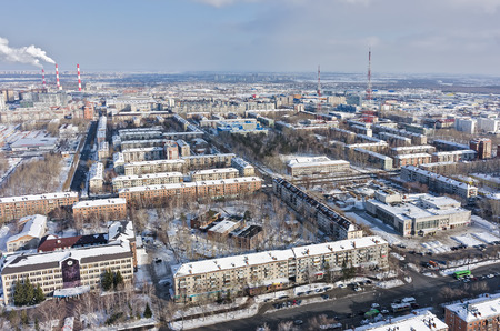 entertaining area: Tyumen, Russia - February 14, 2016: Aerial view onto residential area, entertaining institution of builders and TV towers on background