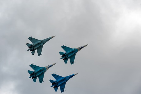pilotage: Nizhniy Tagil, Russia - September 25. 2013: Team flight of russian highest pilotage team on SU-27. Display of fighting opportunities of equipment with application of aviation means of defeat