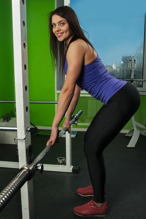 powerlifting: fitness, sport, powerlifting and people concept - sporty woman exercising with weight bar in gym Stock Photo