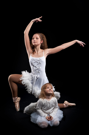 mum and daughter: Mom teaching her daughter dancing. mother and daughter are ballerinas