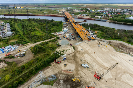 Tyumen, Russia - August 29, 2015: Construction of East Round bridge through Tura River Stock Photo