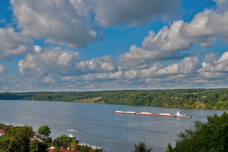 barge: Barge moving in the waterways on Volga river Stock Photo