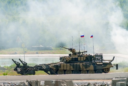 clearer: Nizhniy Tagil, Russia - July 12. 2008: Display of fighting opportunities of arms and military equipment. BMR-3M armoured deminer to demine pathways for convoy