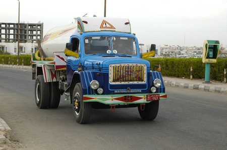 driven: Hurghada, Egypt - November 5, 2006: Old truck driven by arabian driver moves on city street Editorial