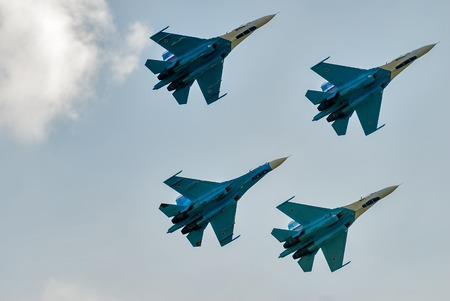 pilotage: Nizhniy Tagil, Russia - July 12. 2008: Group flight of russian highest pilotage team on SU-27. Display of fighting opportunities of equipment with application of aviation means of defeat Editorial