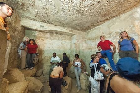 Cairo, Egypt - November 11, 2006: Tourists visit hall inside pyramid of Giza Redakční