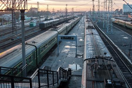 novosibirsk: Novosibirsk, Russia - July 26, 2005: Railway station and railway tracks at evening sun