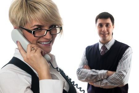 lady on phone: Young business lady talking by mobile phone at isolated background