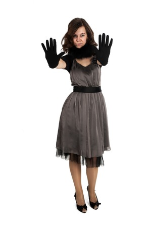 Young beautiful woman with gloves showing stop gesture photo